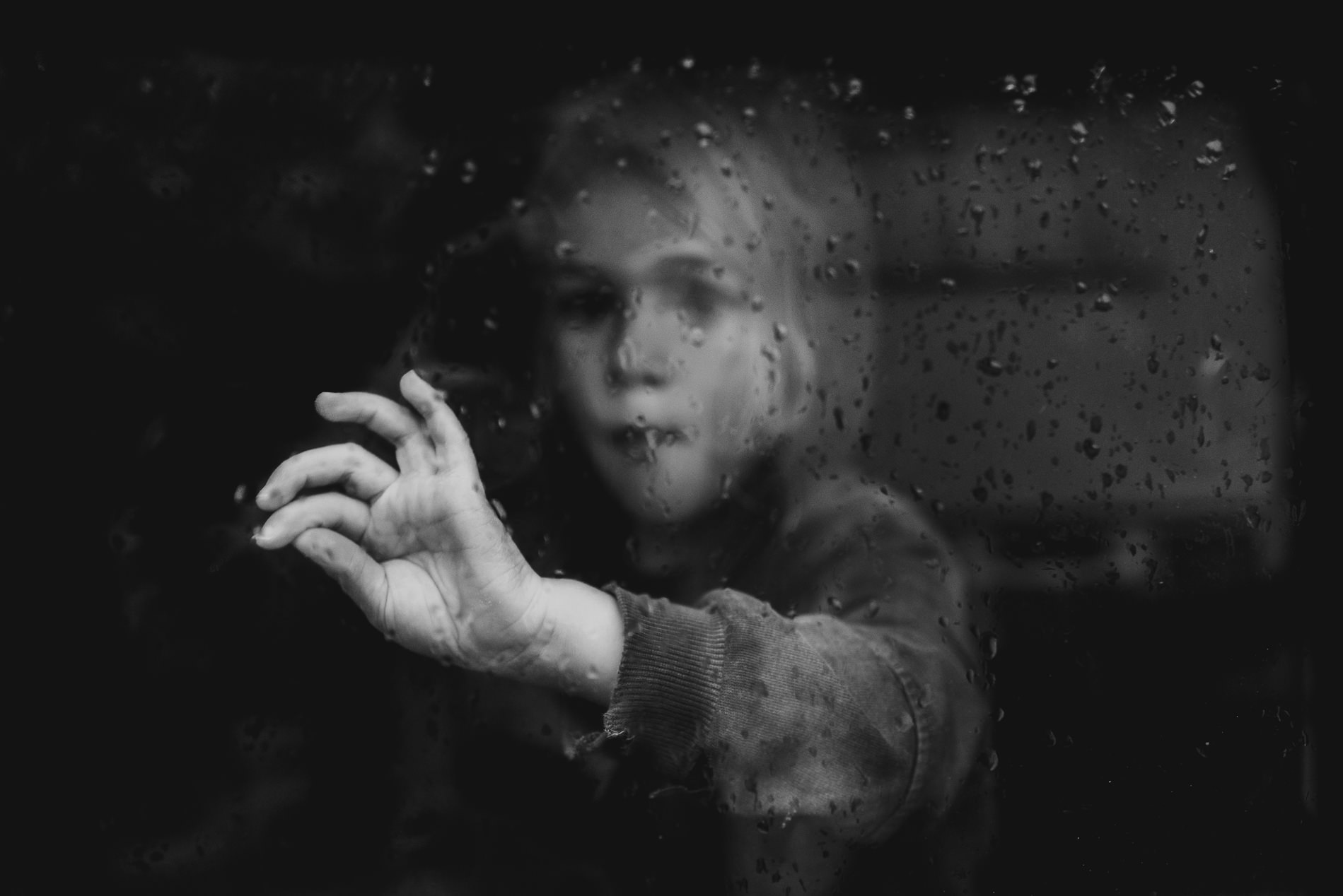 Child at window winter lifestyle blog post